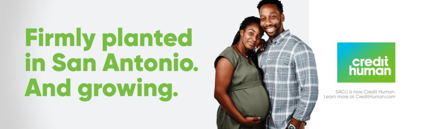 expecting family of two on a billboard supporting their financial stability with credit human