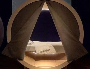 tent opening up to a bed